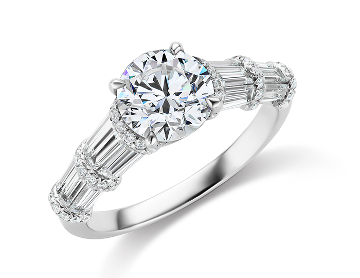 Round brilliant cut and baguette cut diamond engagement ring in platinum.