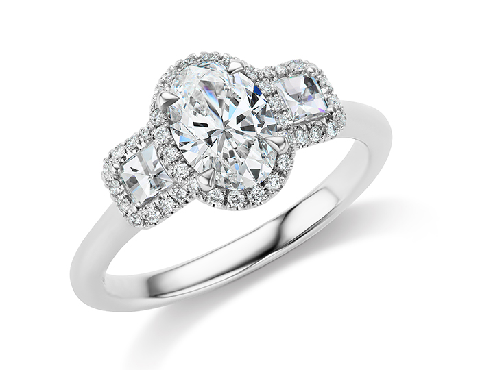Oval cut, blaze cut and round brilliant cut diamond engagement ring in platinum.