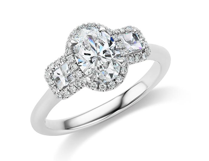 Oval cut, blaze cut and round brilliant cut diamond engagement ring in platinum.