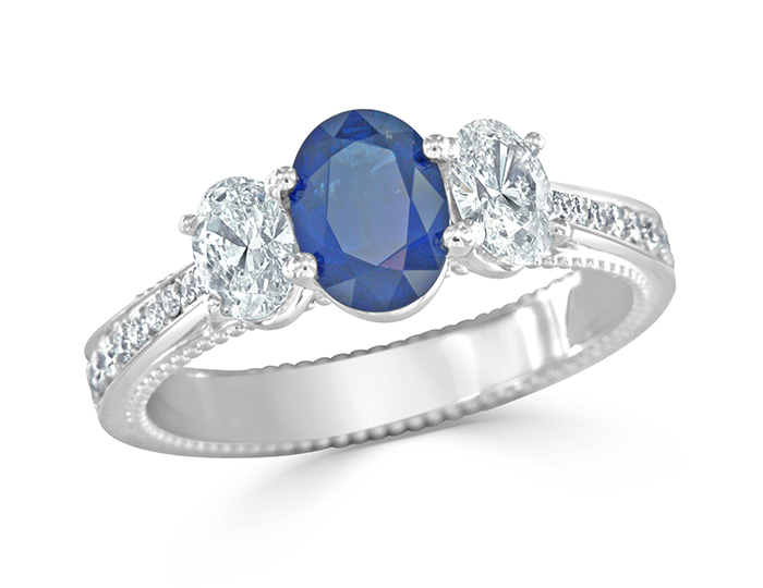 Sapphire ring with oval and round brilliant cut diamonds in platinum.