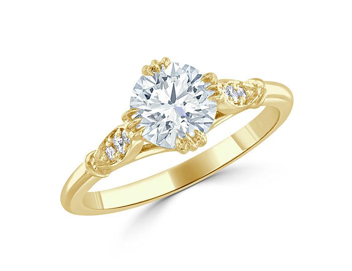 Bez Ambar round brilliant cut diamond engagement ring in 18k yellow gold.