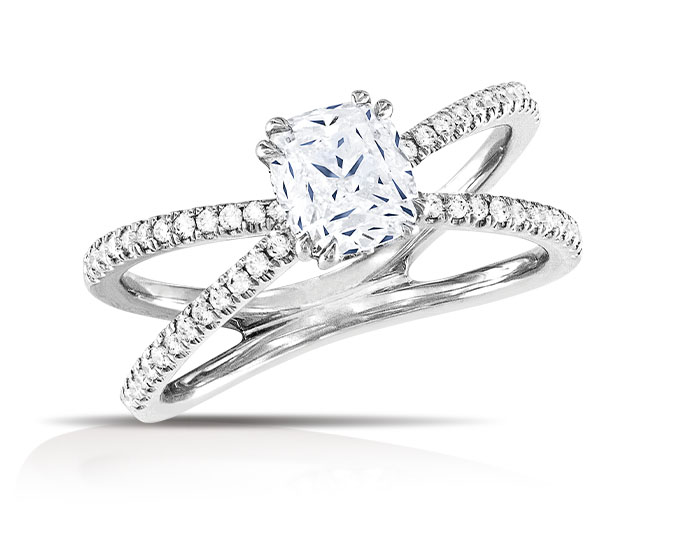 Cushion cut and round brilliant cut diamond engagement ring in 18k white gold.