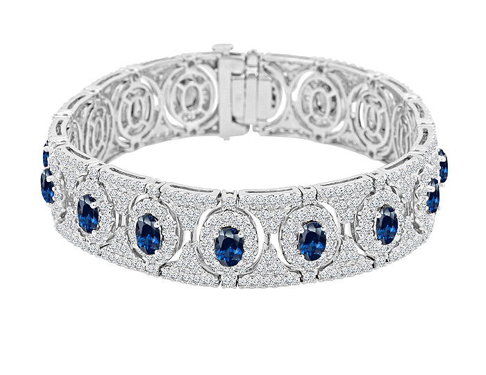Oval shape sapphire and round brilliant cut diamond bracelet in 18k white gold.
