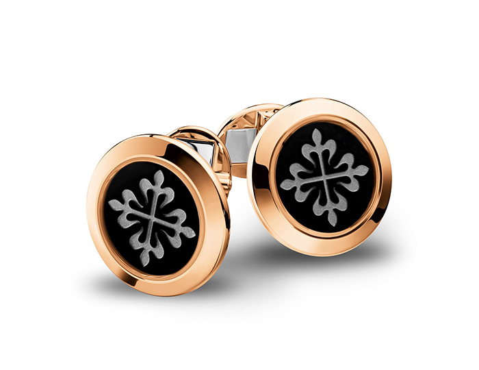 Patek Philippe Calatrava Collection black onyx cufflinks in 18k rose gold.