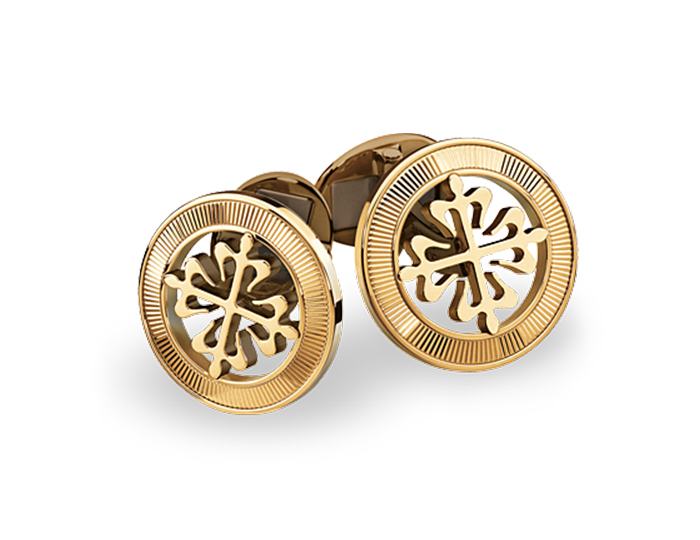Patek Philippe Calatrava Cross cufflinks with guilloched outer ring in 18k yellow gold.