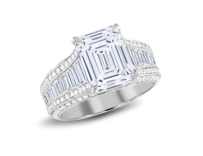 Emerald cut center and baguette and round brilliant cut diamond engagement ring in platinum.