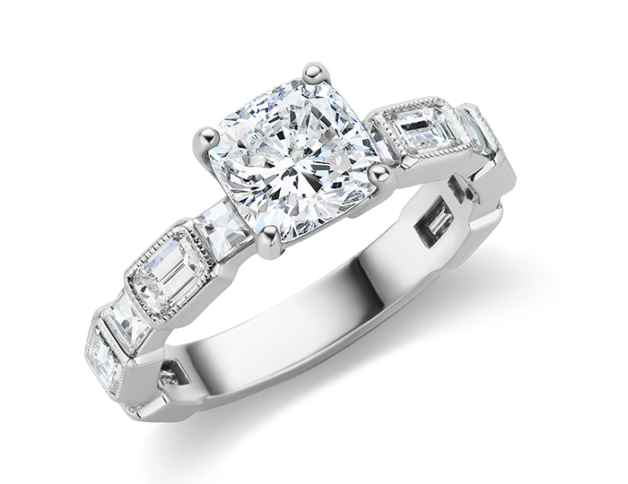 Cushion, baguette and round brilliant cut diamond engagement ring in platinum.