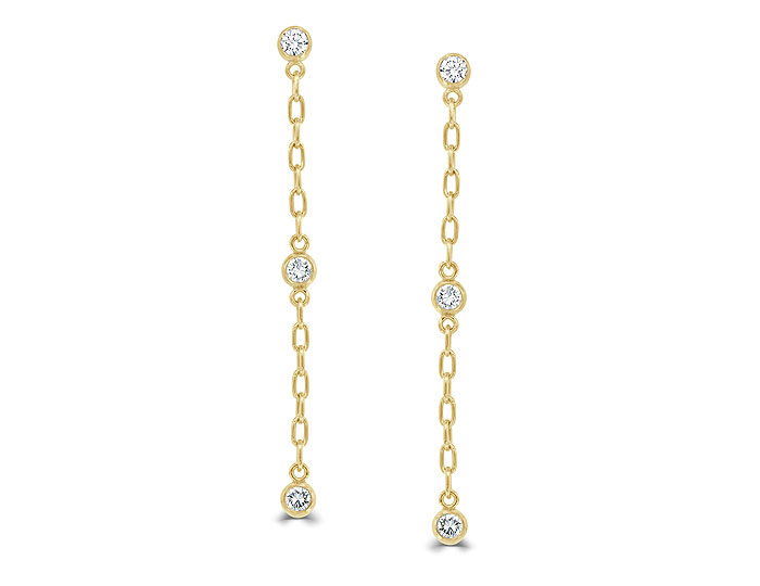 Round brilliant cut diamond dangle earring in 18k yellow gold.