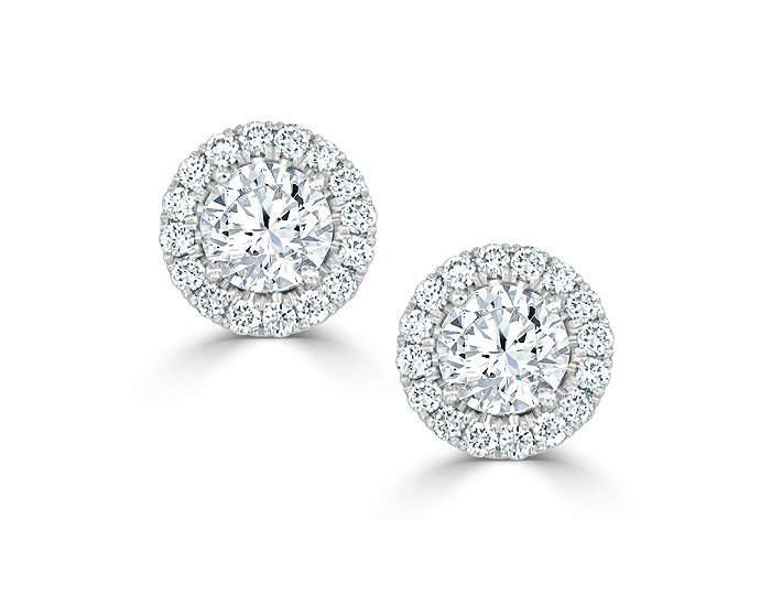 Round brilliant cut diamond halo earrings in 18k white gold.