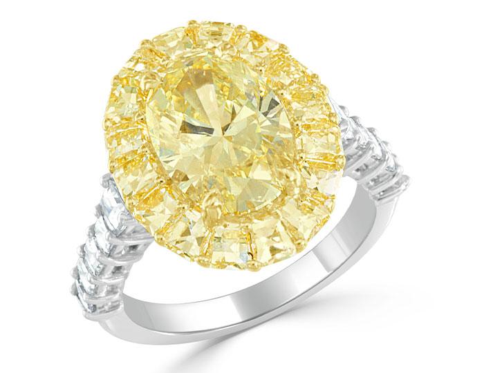 Bez Ambar natural fancy intense yellow oval diamond and yellow and blaze cut diamond engagement ring.