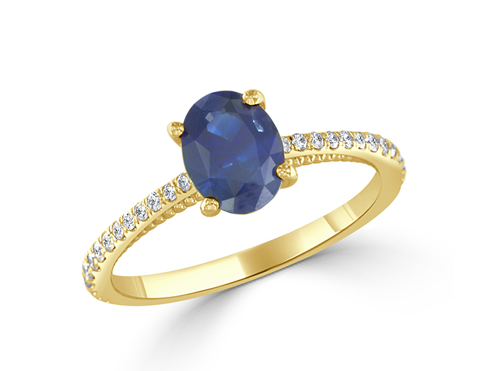 Oval cut sapphire and round brilliant cut diamond ring in 18k yellow gold.