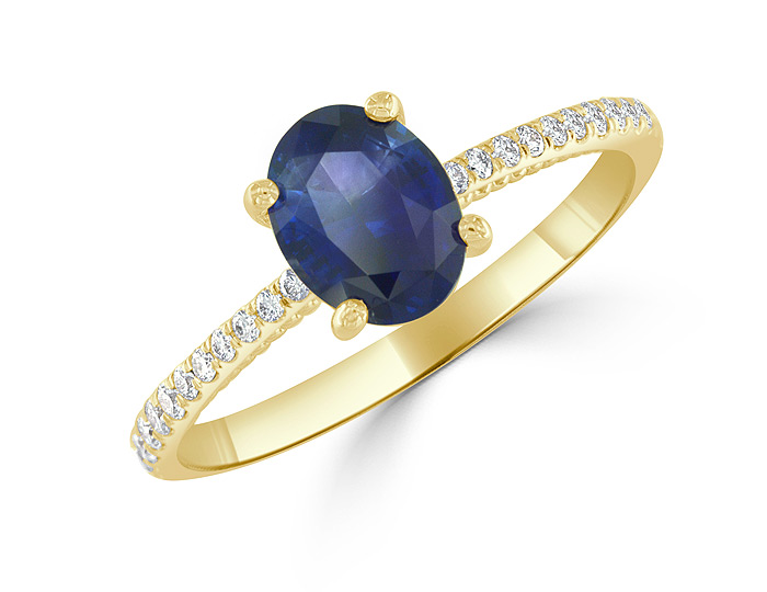 Oval shape sapphire and round brilliant cut diamond ring in 18k yellow gold.