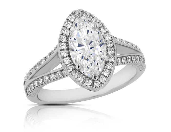 Marquise cut center diamond and round brilliant cut diamond engagement ring in platinum.