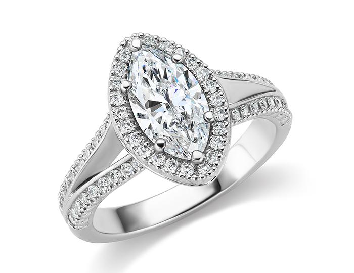 Marquise cut center diamond and round brilliant cut diamond engagement ring in platinum.