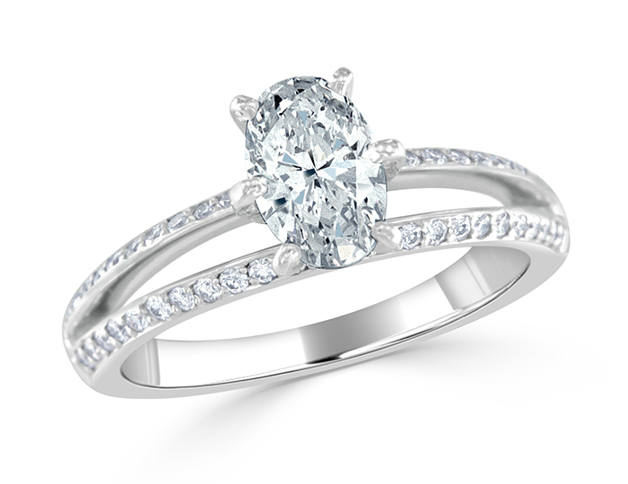 Oval shape and round brilliant cut diamond engagement ring in platinum.