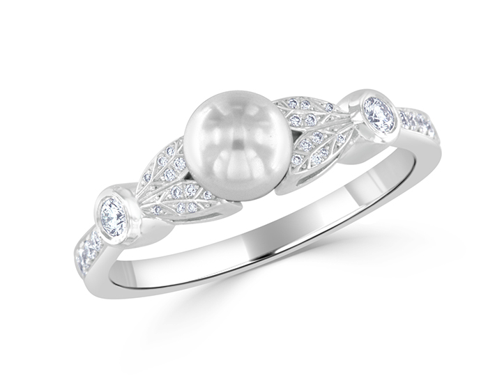 Cultured pearl and round brilliant cut diamond ring in 14k white gold.
