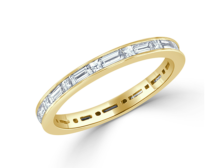 Blaze and baguette cut diamond band in 18k yellow gold.