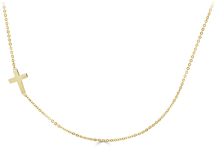 Cross necklace in 14k yellow gold.