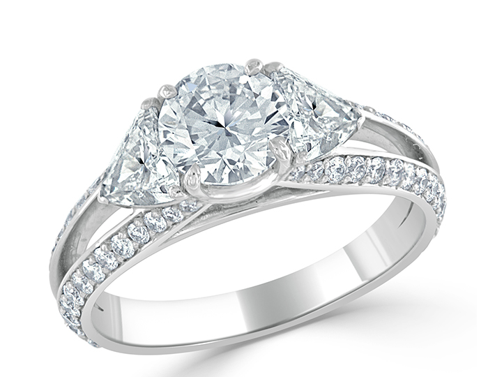 Bez Ambar round brilliant cut and trillion cut diamond engagement ring in platinum.