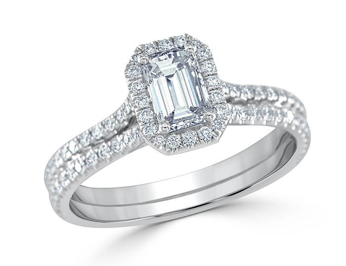 Emerald cut and round brilliant cut diamond engagement ring in 18k white gold.