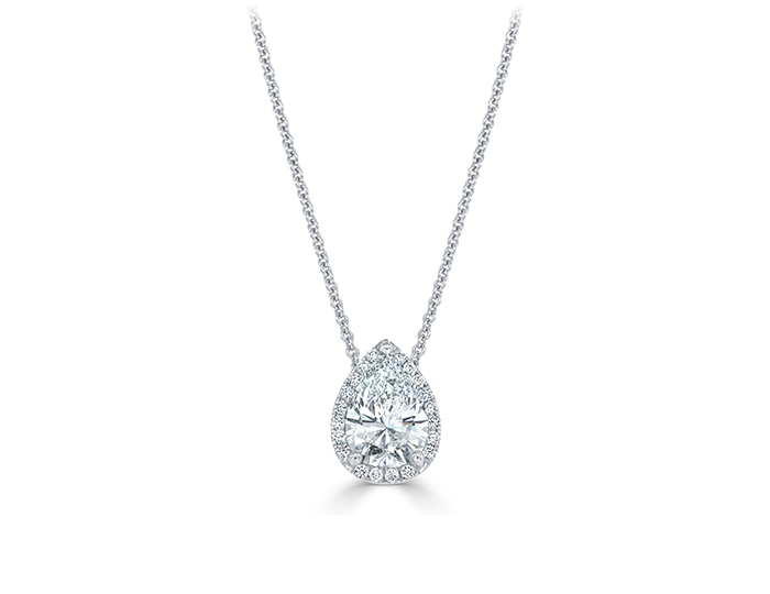 Pear shape and round brilliant cut diamond halo pendant in 18k white gold.