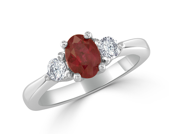 Oval ruby and round brilliant cut diamond ring in platinum.