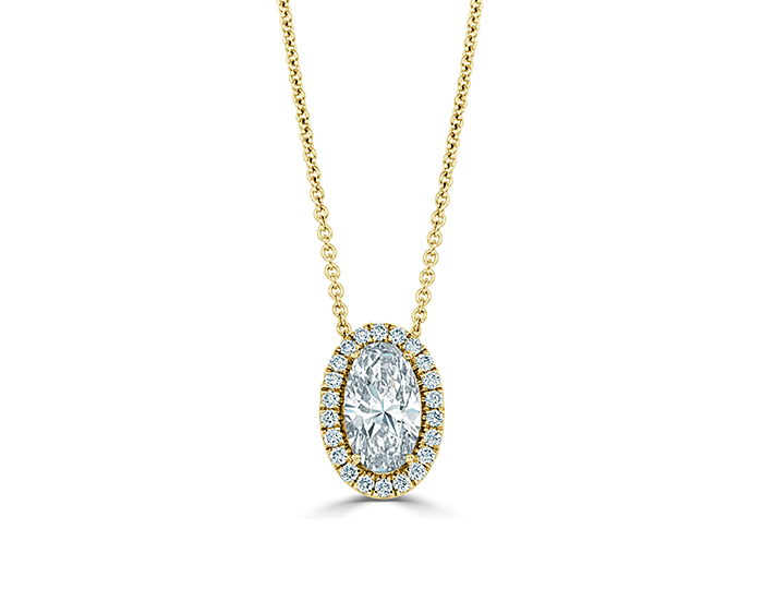 Oval and round brilliant cut diamond pendant in 18k yellow gold.