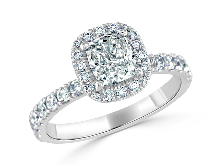 Cushion cut and round brilliant cut diamond ring in 18k white gold.