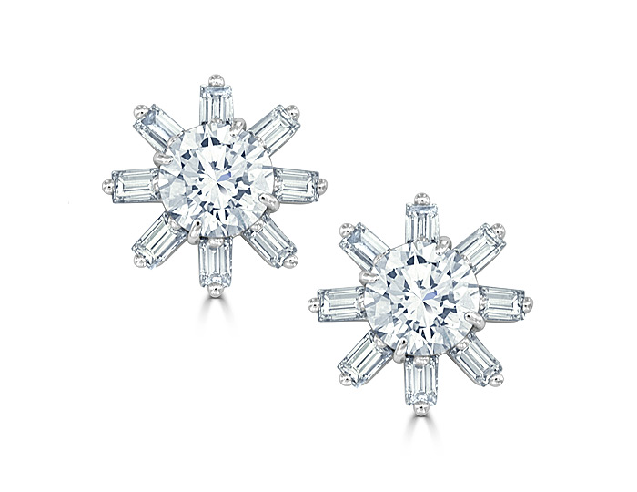 Round brilliant cut and baguette cut diamond earrings in 18k white gold.
