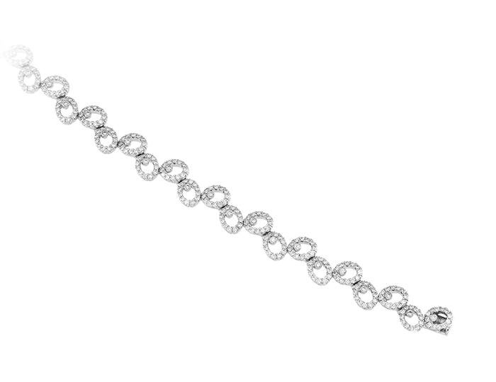 Round brilliant cut diamond bracelet in 18k white gold.