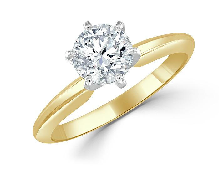 Round brilliant cut diamond engagement in 18k yellow gold.