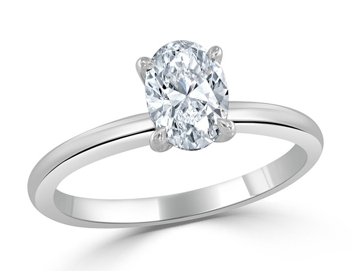 Oval cut diamond solitaire engagement ring in platinum.