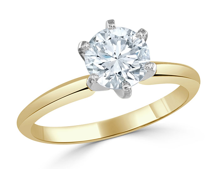 Round brilliant cut diamond engagement ring in 18k yellow gold and platinum.