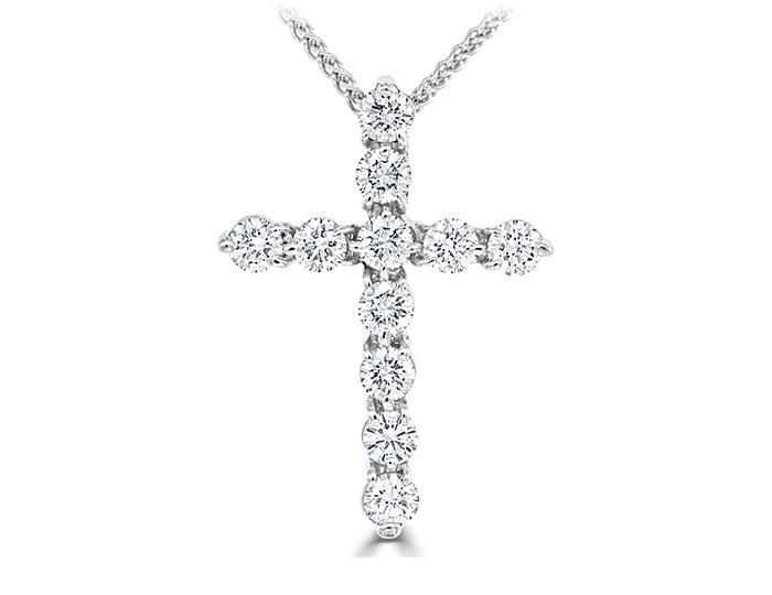 Round brilliant cut diamond cross in 18k white gold.
