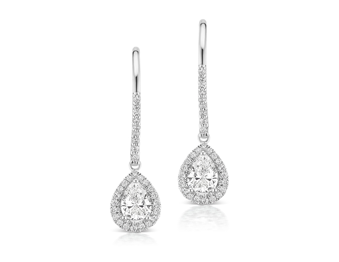 Pear shape and round brilliant cut diamond earrings in 18k white gold.