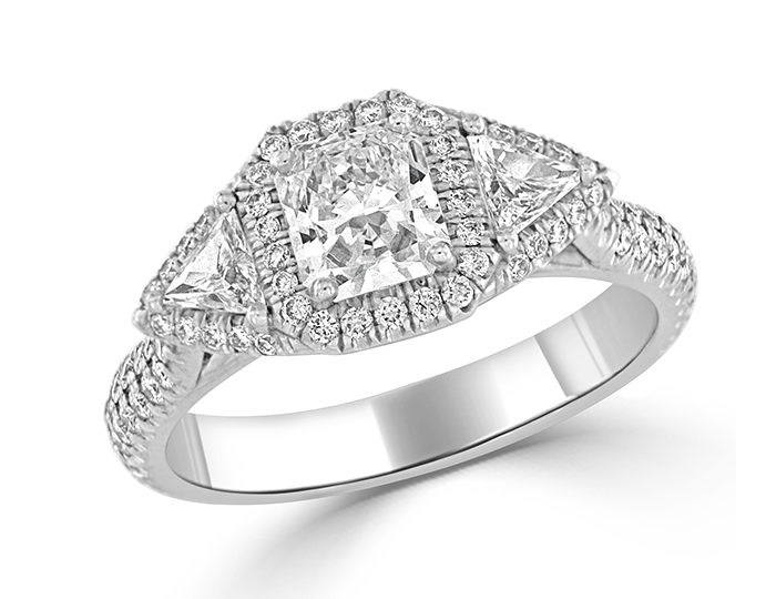 Radiant cut, trillion shape and round brilliant cut diamond engagement ring in 18k white gold.