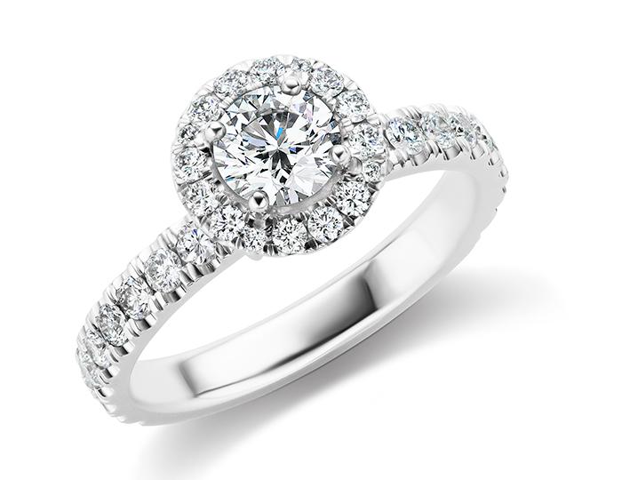 Round brilliant cut diamond engagement ring in 18k white gold.