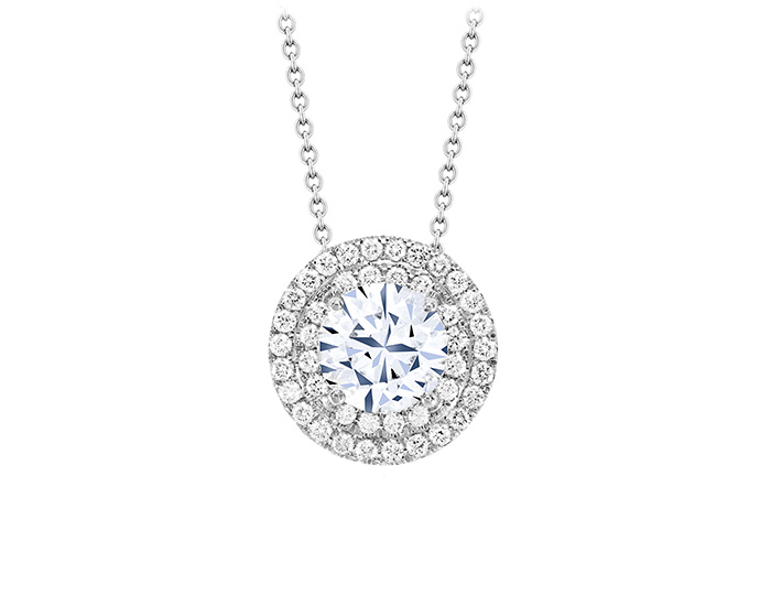 Round brilliant cut diamond double halo pendant in 18k white gold.