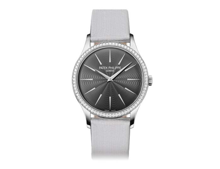 Patek Philippe Calatrava womens 18k white gold mechanical manually wound diamond strap watch featuring guilloched silvery gray dial. (4897G-010)