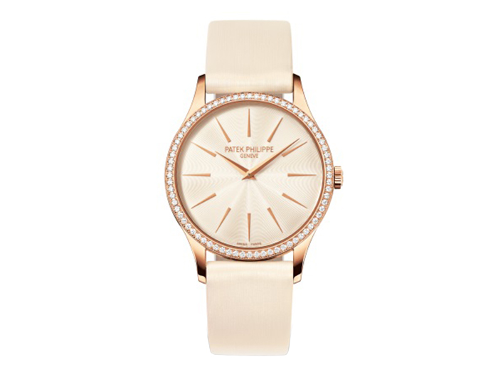 Patek Philippe Calatrava ladies 18k rose gold mechanical manually wound diamond bezel strap watch featuring a cream guilloched dial. (4897R-010)