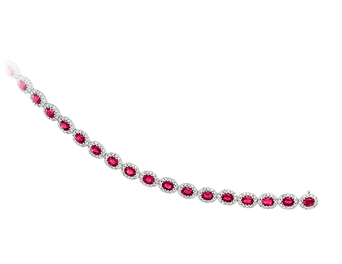 Ruby and round brilliant cut diamond bracelet in 18k white gold.