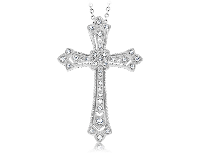 Round brilliant cut diamond cross in 18k white gold.