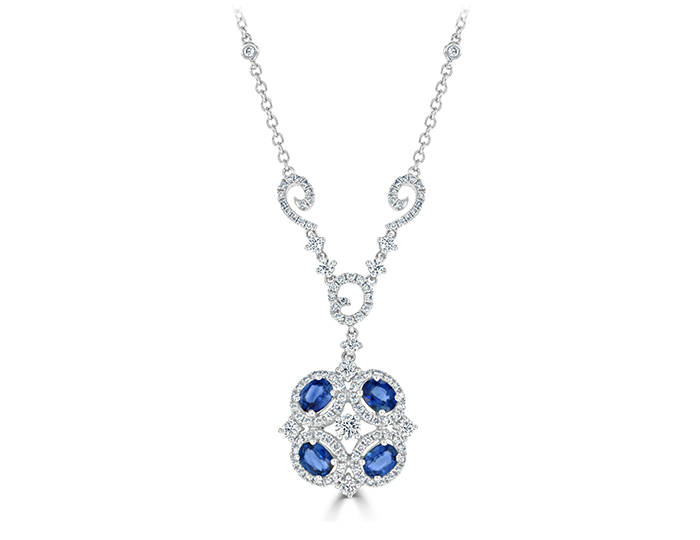 Oval cut sapphire and round brilliant cut diamond necklace in 18k white gold.