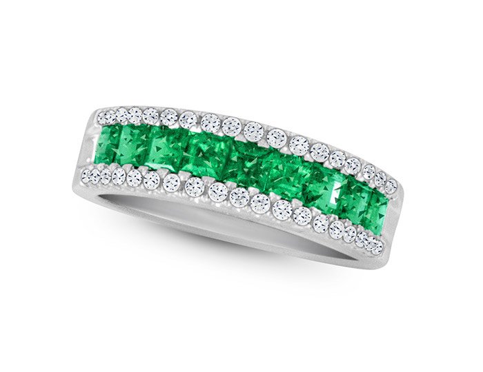 Emerald and round brilliant cut diamond ring in 18k white gold.