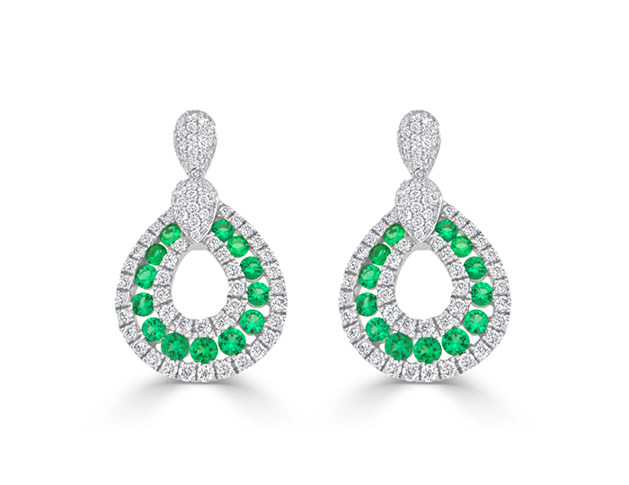 Emeralds with round brilliant cut diamond earrings in 18k white gold.