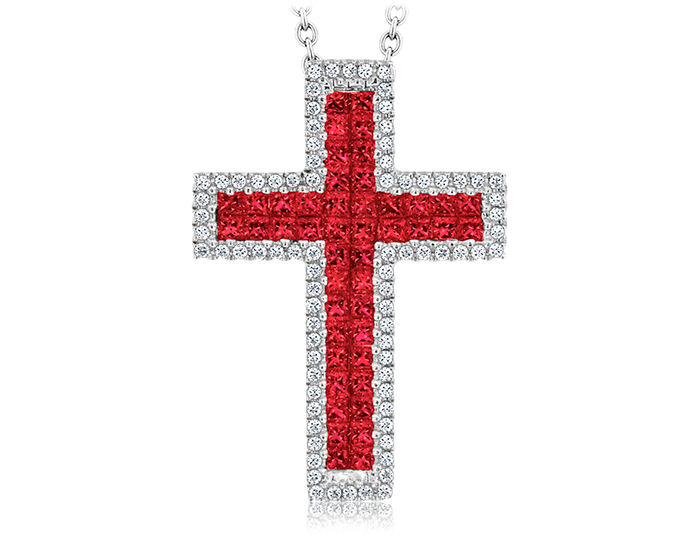 Ruby and round brilliant cut diamond cross in 18k white gold.