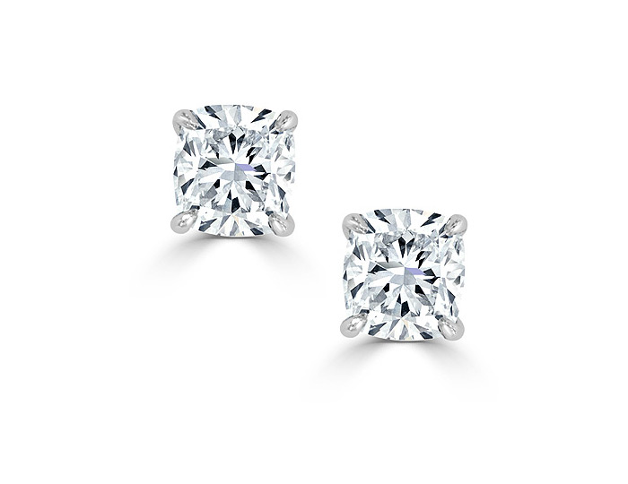 Cushion cut diamond stud earrings in platinum.