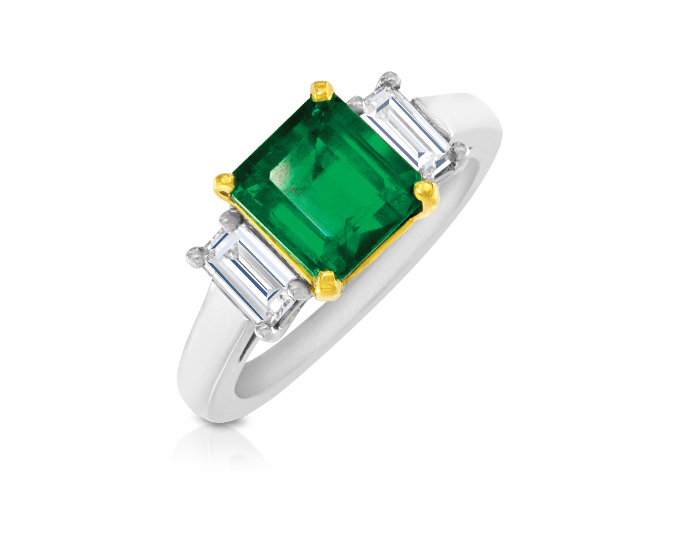 Emerald with emerald cut diamond ring in platinum and 18k yellow gold.