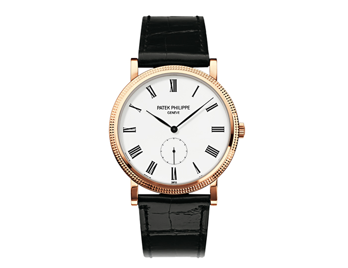 Patek Philippe Calatrava mens 18k rose gold mechanical manually wound strap watch featuring a white lacquered dial.  (5119R-001)