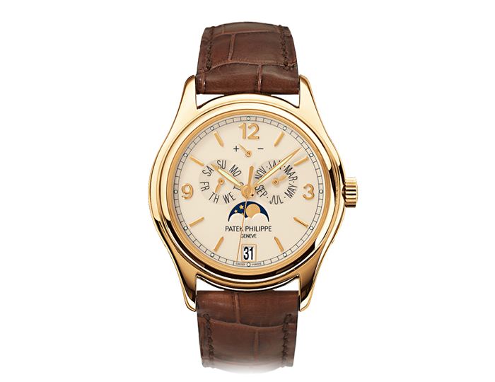 Patek Philippe annual calendar mens 18k yellow gold mechanical self-winding strap watch featuring day and month by hands, date in an aperture and moon phases with a cream dial. (5146J-001)